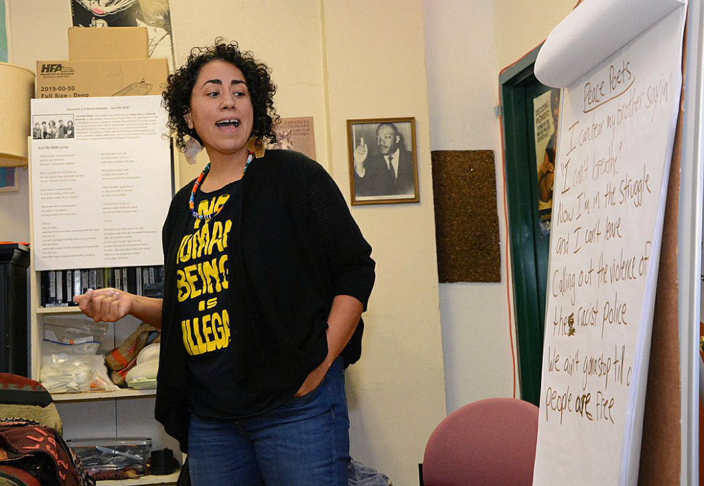 "Social justice songwriter, musician and activist,Taina Asili sings, ""I Can't Breath"" with participants during a hands-on songwriting workshop program called: Reclaim the Thunder: Songs for Social Change, at The Social Justice Center in Albany"